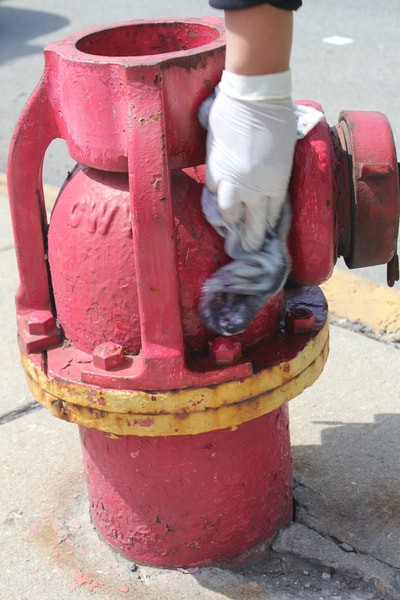 Remove Graffiti From a Painted Metal Fire Hydrant